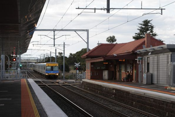 Alstom Comeng 584M arrives into Diggers Rest station on an up Sunbury service