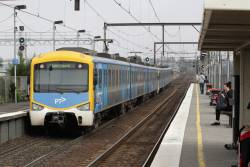 Siemens train departs South Kensington with a down Werribee service