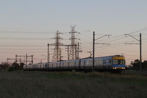 Alstom Comeng leads a down Sunbury service at Ginifer