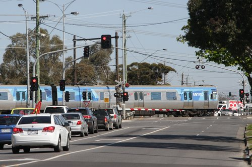Alstom Comeng 669M crosses the soon to be removed Furlong Road level crossing at Ginifer