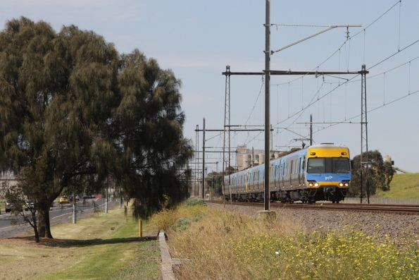 Alstom Comeng leads a down Watergardens service between Albion and Ginifer