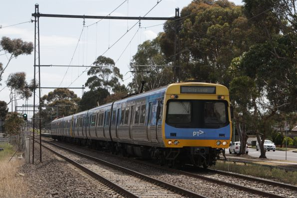 EDI Comeng 525M leads a citybound service out of Ginifer station