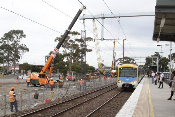 Citybound Sunbury service arrives into St Albans, with grade separation works underway on the opposite side