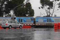 Comeng train passes through the soon to be removed Main Road level crossing at St Albans