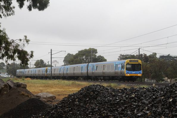 EDI Comeng 513M departs Keilor Plains on the down