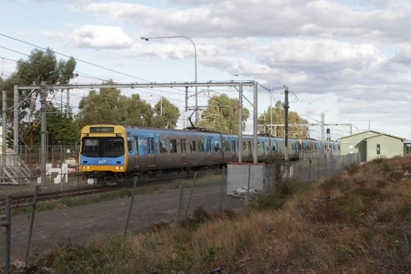 Comeng on a down Sunbury service departs Watergardens station