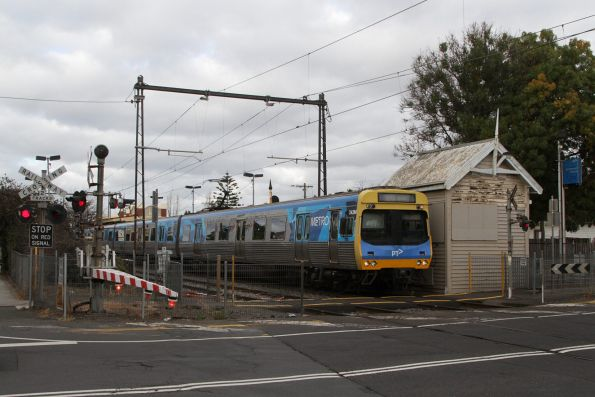EDI Comeng 343M leads an up service at Spotswood