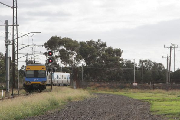 EDI Comeng on an up Werribee service rejoins the mainline at Altona Junction