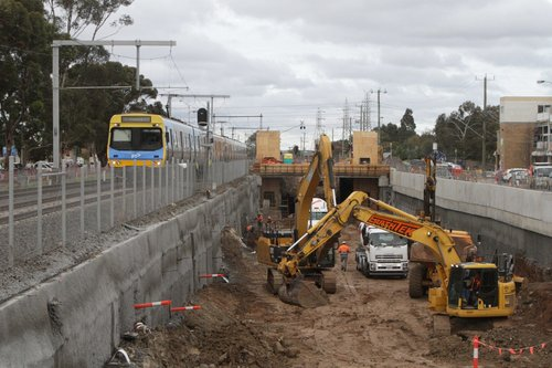 EDI Comeng on a down Sunbury service passes grade separation works at Ginifer station