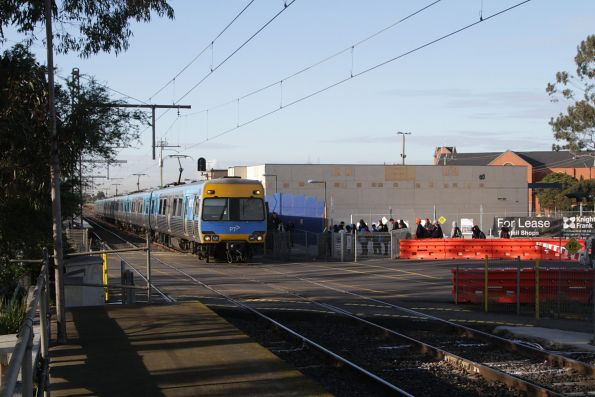 Down Comeng train crosses the Main Road level crossing at St Albans
