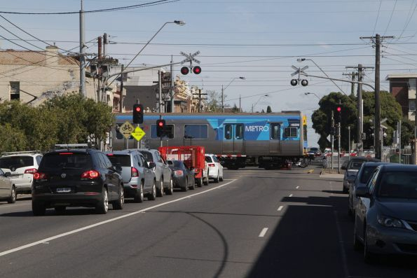 Comeng 468M on a down Upfield service crosses the Brunswick Road level crossing