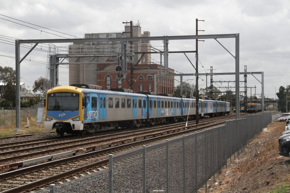 Siemens train arrives at Albion on a down Watergardens service, with an up service in the distance