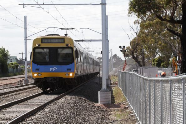 Citybound Comeng train back at ground level between St Albans and Ginifer