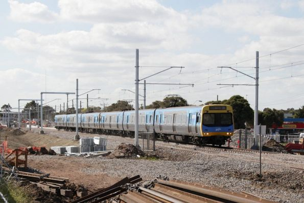 Citybound Comeng train returns to ground level after departing St Albans station