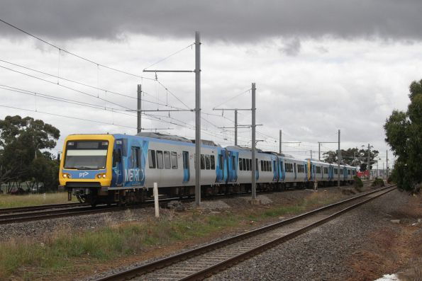 X'Trapolis 875M leads an up Werribee service at Aircraft