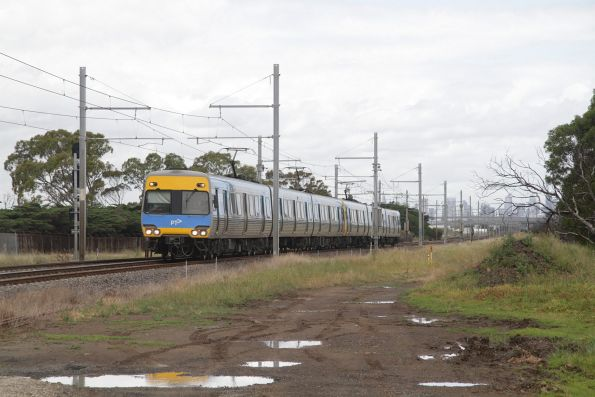 Alstom Comeng leads a down Werribee service via the main line at Galvin