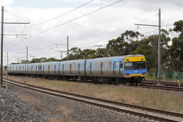 Alstom Comeng leads an up Werribee service via the main line at Galvin