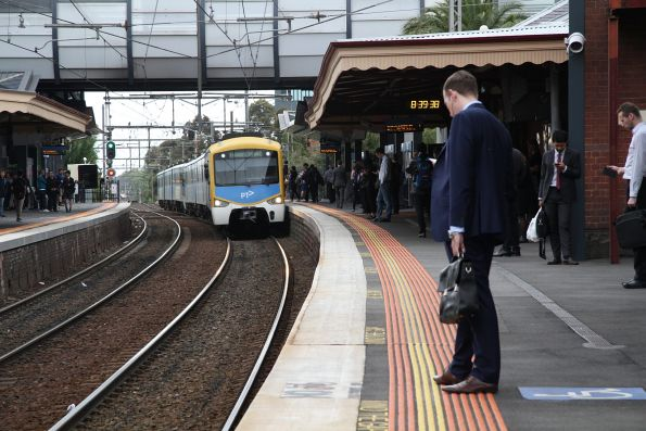 Siemens train arrives into Footscray with an up train from Newport
