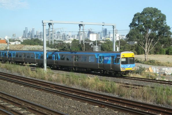 Alstom Comeng 491M leads a down Werribee service towards Footscray