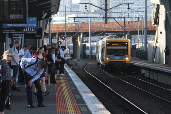 X'Trapolis train arrives into North Melbourne platform 6 with a down Williamstown service