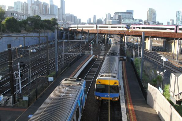 Up and down trains pass at North Melbourne platform 5 and 6
