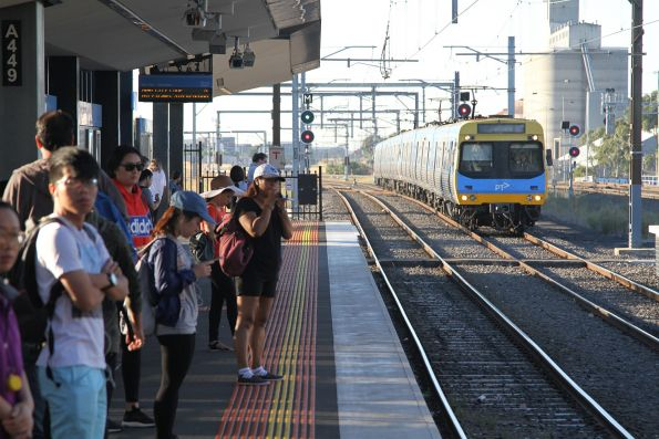 Crowd of passengers at Sunshine waiting for a citybound train on a Sunday morning