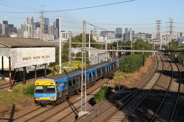 Comeng passes the mill sidings at Kensington on an up Craigieburn service