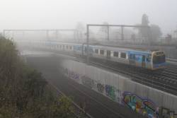 Comeng train arrives into Footscray with an up Sunbury service