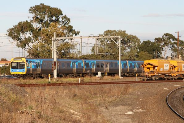 Comeng 398M leads a down Watergardens train out of Sunshine