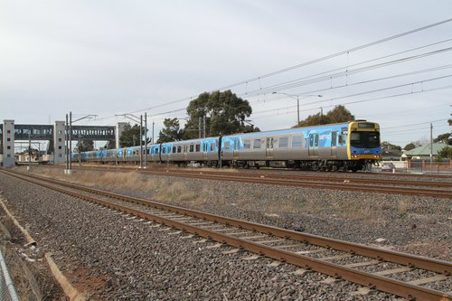 Comeng 327M leads a down Werribee service out of Laverton