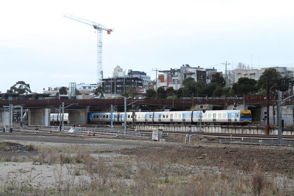 Citybound Alstom Comeng passes under the North Melbourne flyover