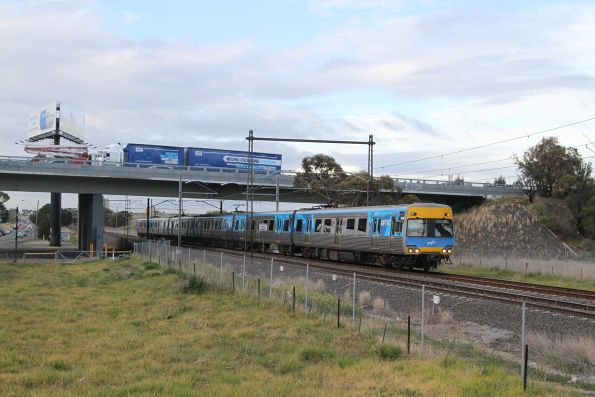 Alstom Comeng 608M passes under the Western Ring Road on a down service