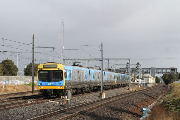 EDI Comeng train departs Laverton station on the up