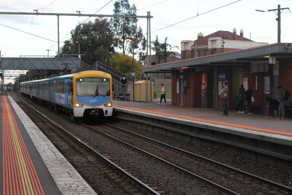 Siemens train arrives into Seddon station on the up