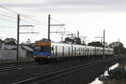Alstom Comeng train arrives at Hoppers Crossing with an up Werribee service