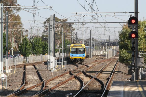 Empty train shunts out of the yard at Watergardens station
