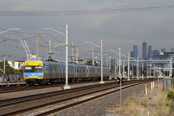 Citybound Comeng train approaches West Footscray station
