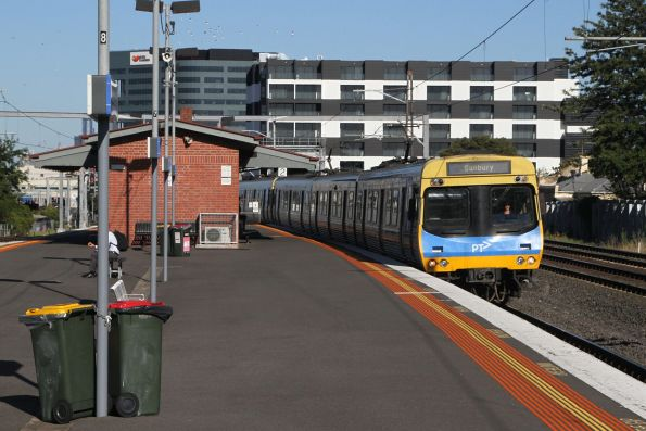 EDI Comeng train passes Middle Footscray on a down Sunbury service