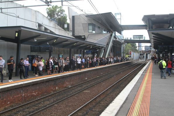 Train load of V/Line passengers from Seymour waiting for a City Loop train at North Melbourne platform 1