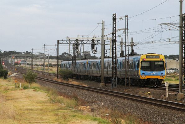 Citybound Altona Loop train crawls along after rejoining the main line at Altona Junction