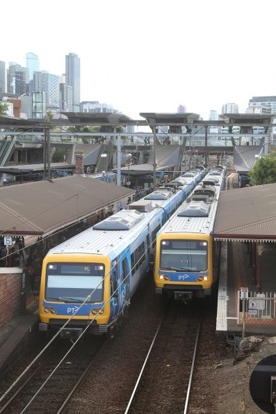 Pair of X'Trapolis trains pass at North Melbourne station