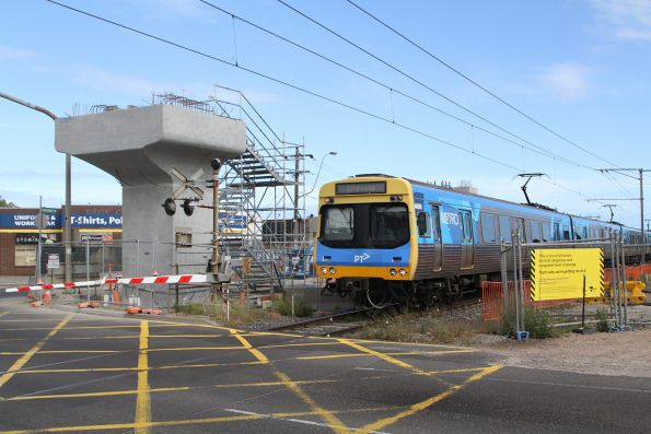 EDI Comeng 466M passes work on the Kororoit Creek Road level crossing removal project at Altona North