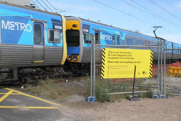 Comeng 465M and 475M pass work on the Kororoit Creek Road level crossing removal project at Altona North