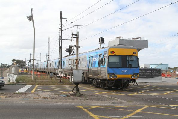 Alstom 476M passes work on the Kororoit Creek Road level crossing removal project at Altona North