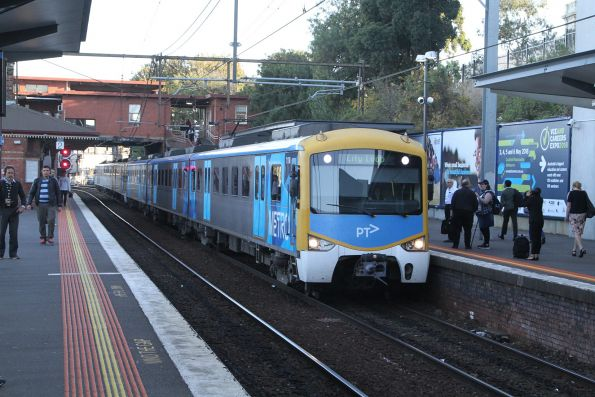 Siemens 717M arrives into North Melbourne on the up