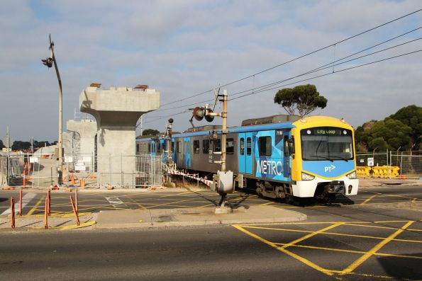 Siemens 711M leads an up Werribee service past level crossing removal works at Kororoit Creek Road