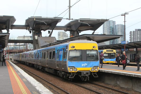 Comeng trains on down Sunbury and Laverton services run parallel at North Melbourne station