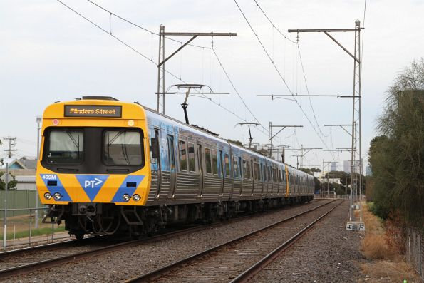 EDI Comeng 409M trails an up Upfield service at Coburg