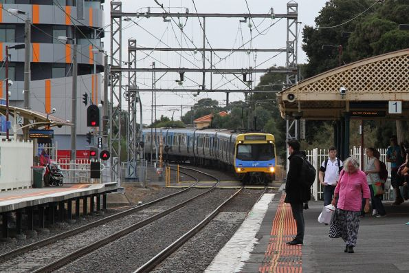 EDI Comeng train arrives into Coburg station with an up Upfield service