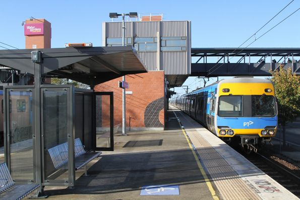 Alstom Comeng arrives into Watergardens station on a down Sunbury service